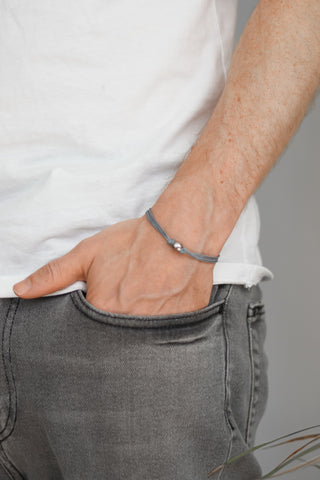 Men's bracelet with silver bead charm and a gray cord - shani-adi-jewerly