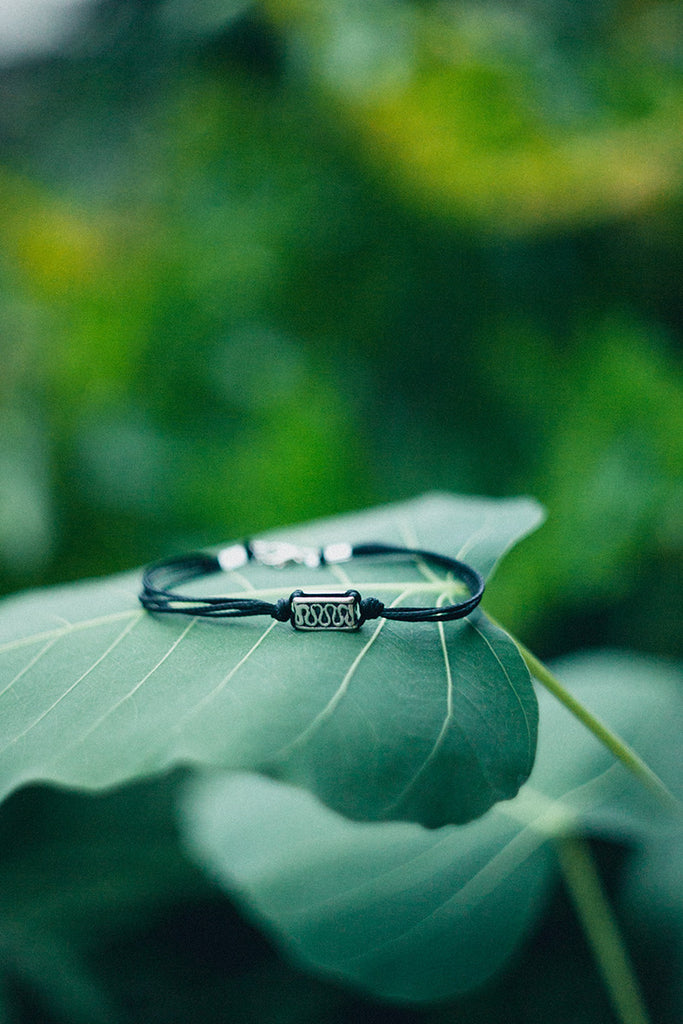 Black cord men's bracelet with silver square bead and spiral engraving