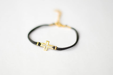 Women's bracelet with gold tone outline cross charm, black cord - shani-adi-jewerly