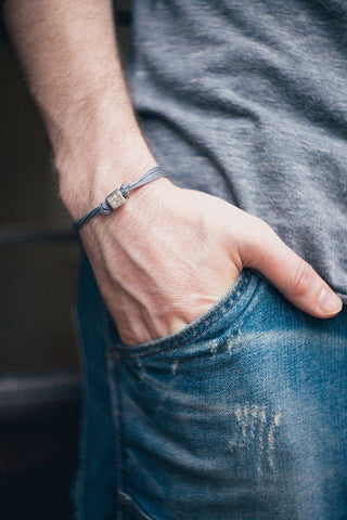 Men's bracelet with a silver tube charm and a gray cord - shani-adi-jewerly