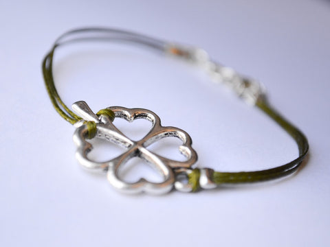Cord bracelet with a silver tone four leaf clover charm - shani-adi-jewerly