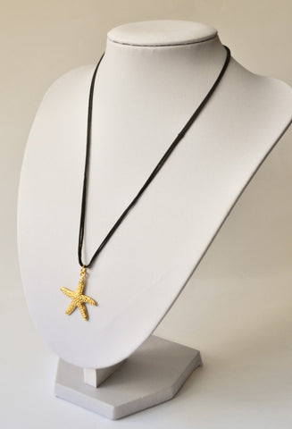 Gold sea star necklace on a black wax cord - shani-adi-jewerly