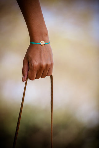 Turquoise cord bracelet with gold endless knot charm - shani-adi-jewerly