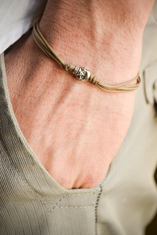 Men's bracelet with a silver skull charm and a brown cord - shani-adi-jewerly