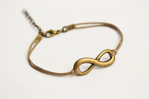 Brown cord bracelet with a bronze endless charm - shani-adi-jewerly