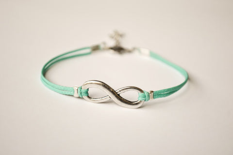 turquoise cord bracelet with a silver infinity charm - shani-adi-jewerly