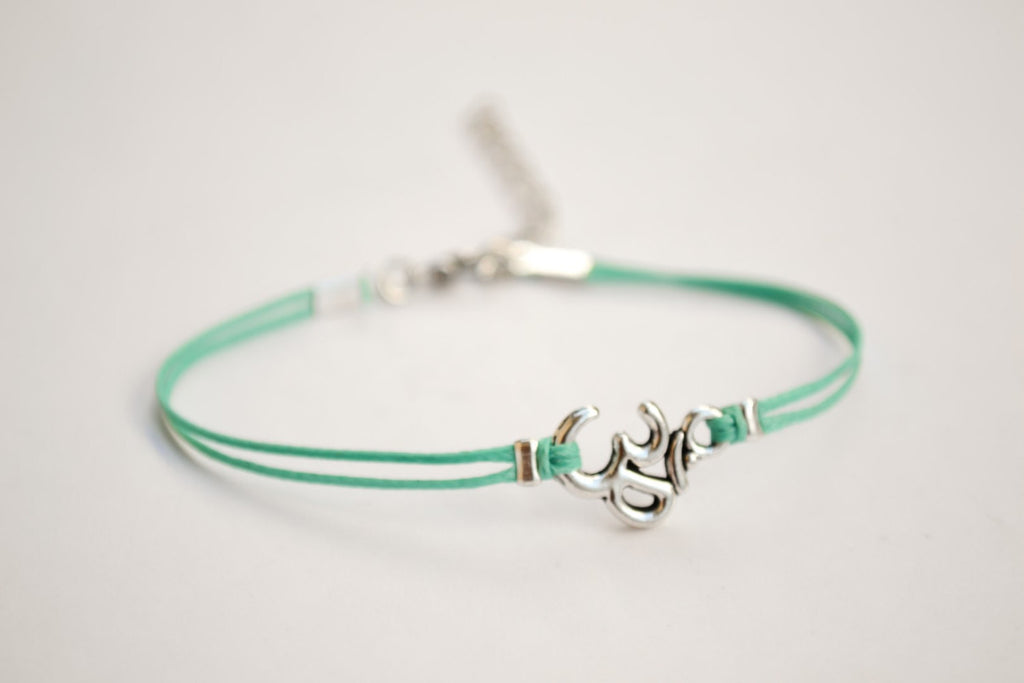 Turquoise bracelet with Tibetan silver Om charm - shani-adi-jewerly