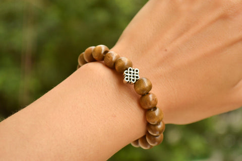 Wood beads stretch bracele with silver celtic endless knot charm - shani-adi-jewerly