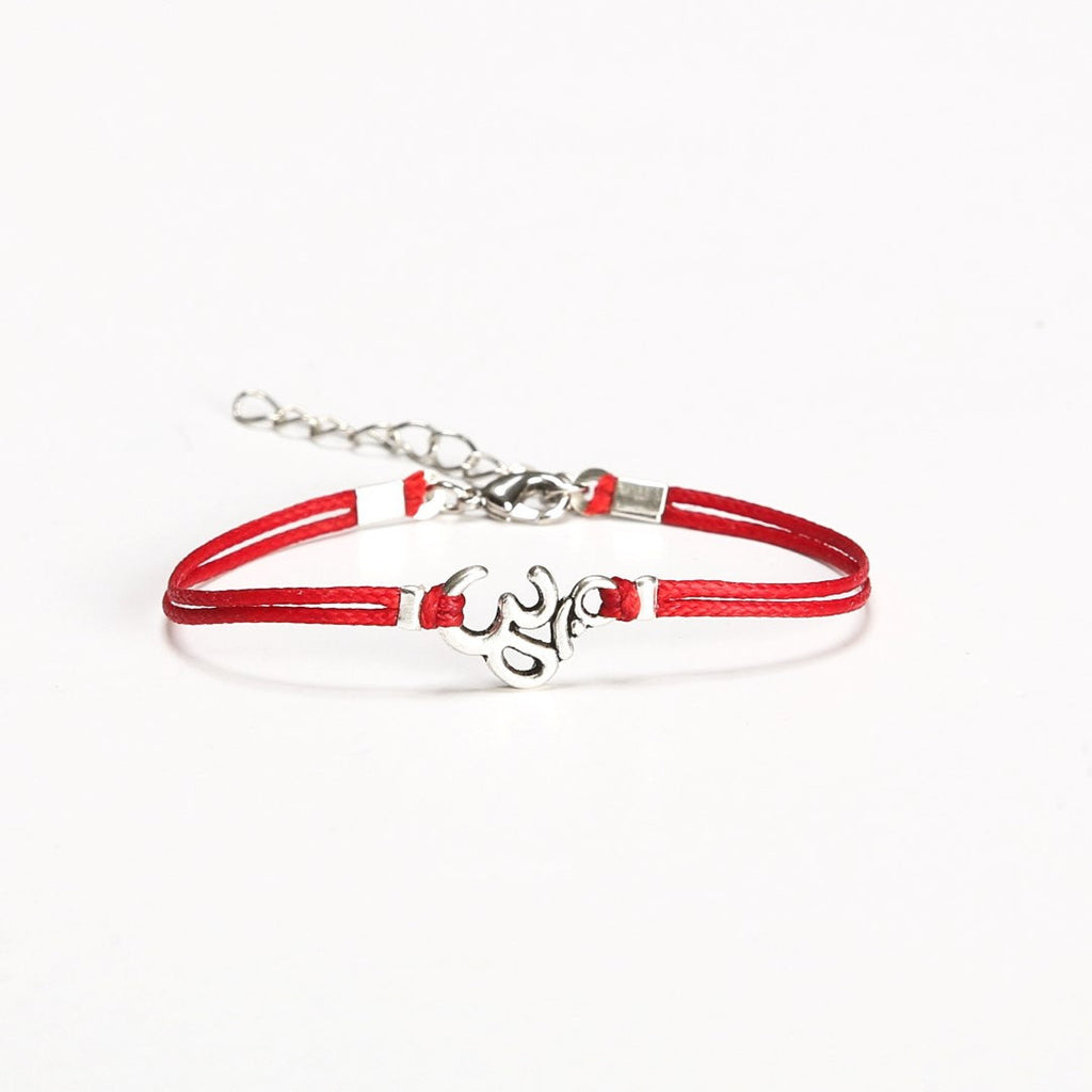 Women bracelet with Tibetan silver Om charm, red cord - shani-adi-jewerly