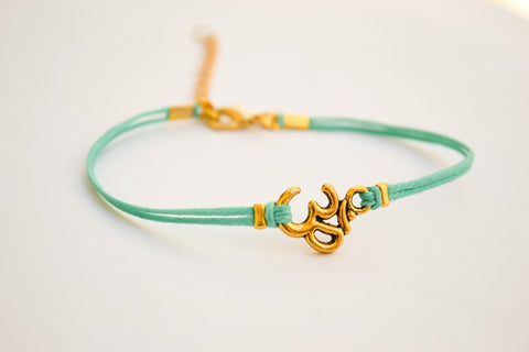 Turquoise bracelet with gold tone Om charm - shani-adi-jewerly