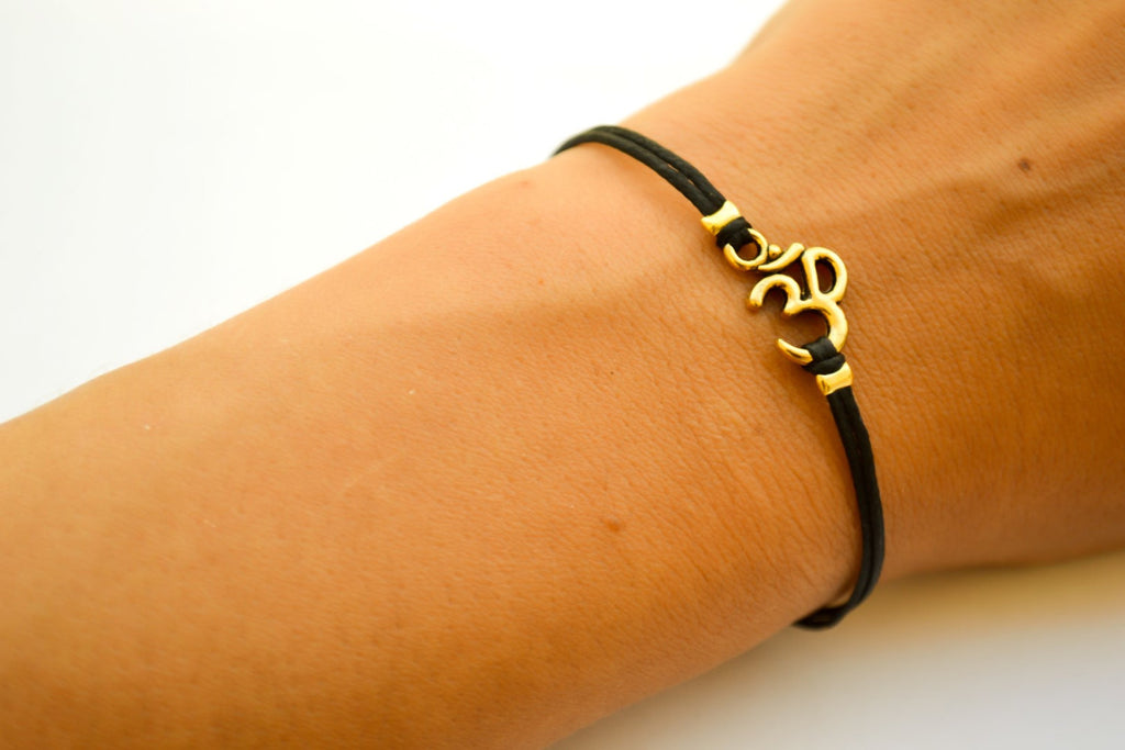 Black cord bracelet with gold tone Om charm, adjustable bracelet for her - shani-adi-jewerly