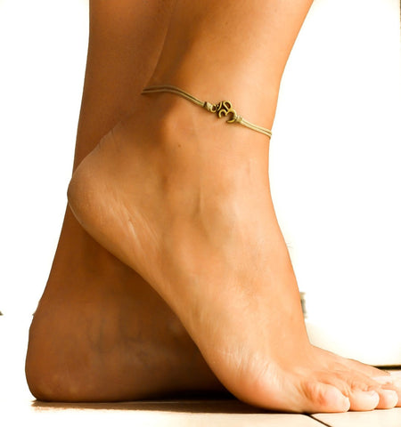 Brown cord anklet with bronze tone Om charm - shani-adi-jewerly