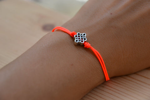 Bright peach cord bracelet with a silver endless knot bead - shani-adi-jewerly