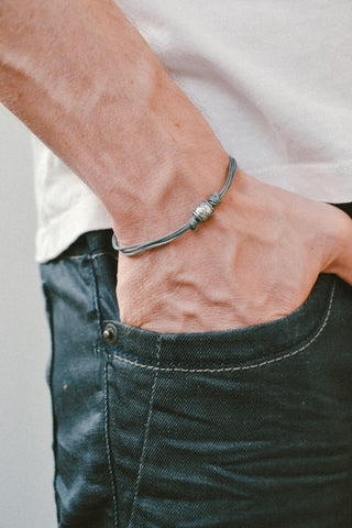 Grey cord bracelet, silver tribal aztec tube charm for men
