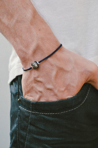 Silver tube bracelet for men, blue cord