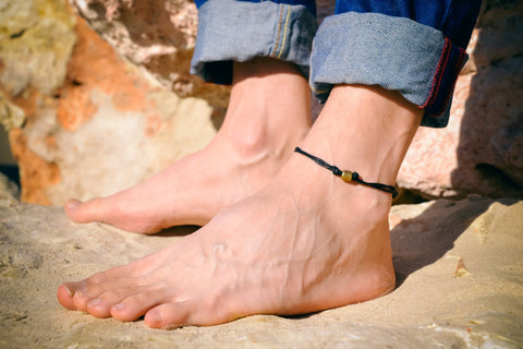 Men's anklet with a bronze tube charm and a black cord - shani-adi-jewerly
