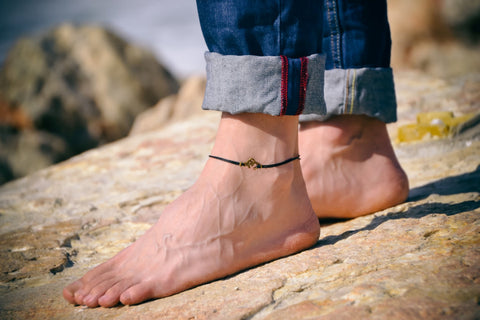 Men's anklet with a bronze Ohm - shani-adi-jewerly