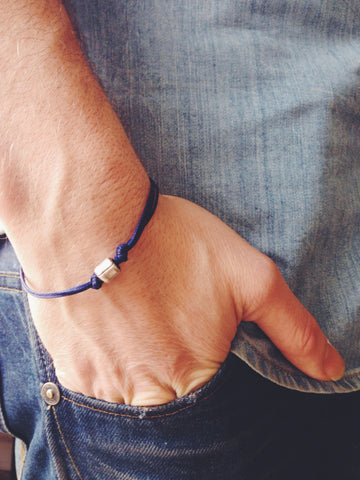 Silver tube bracelet for men with blue cord