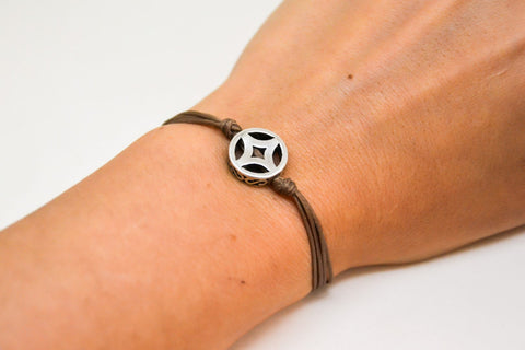Brown cord bracelet with decorated silver circle bead charm - shani-adi-jewerly