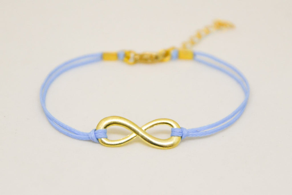 Gold infinity bracelet, womens bracelet with a blue cords, adjustable - shani-adi-jewerly