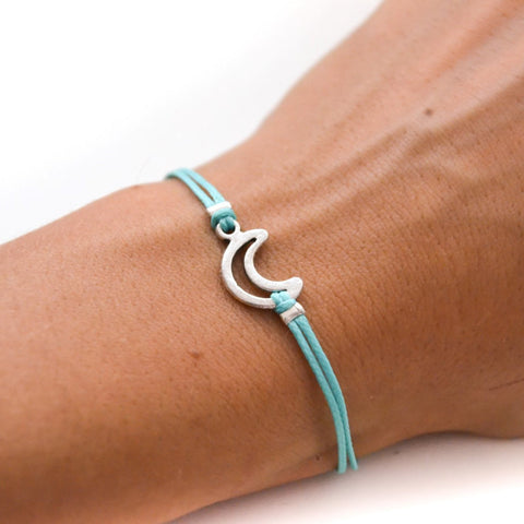 Turquoise cord bracelet with a silver crescent moon charm - shani-adi-jewerly