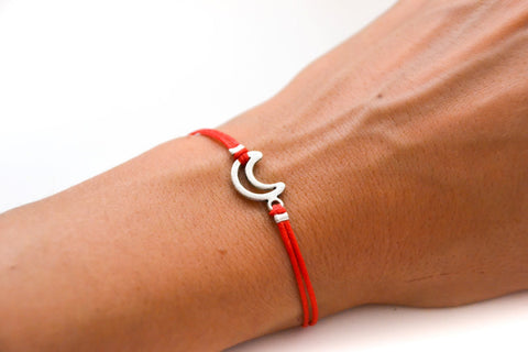 Red cord bracelet with a silver crescent moon charm - shani-adi-jewerly