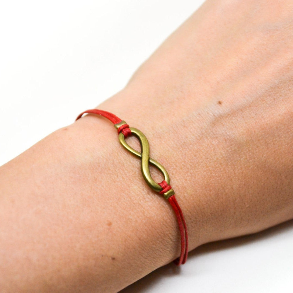 Red cord bracelet with a bronze endless infinity charm - shani-adi-jewerly
