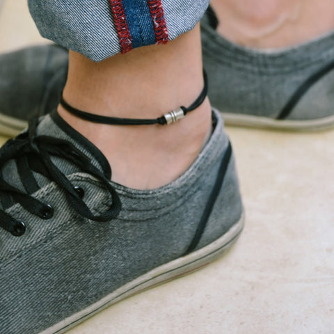 Men's anklet with a silver tube charm and a black cord - shani-adi-jewerly