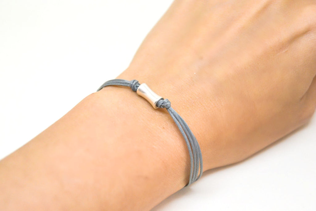 Silver tube bracelet, gray cord bracelet with a silver tone short bead tube, gray string. stack bracelet, minimalist jewelry, gift for her