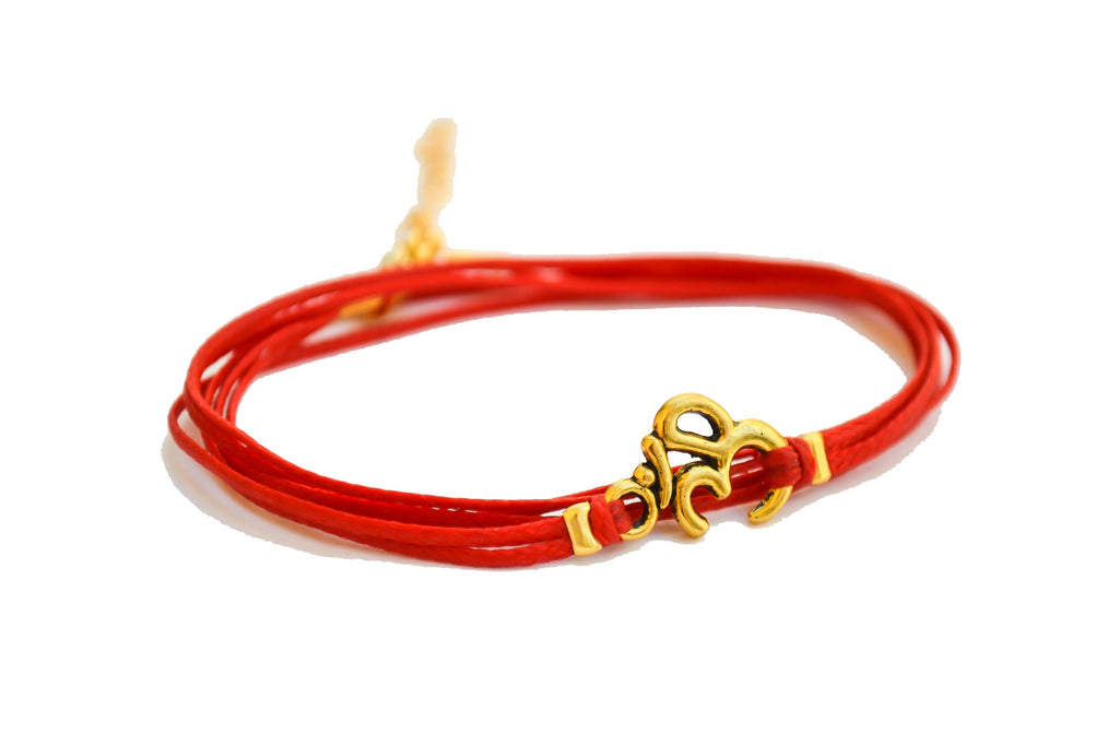 Wrapped red bracelet with gold tone Om charm - shani-adi-jewerly
