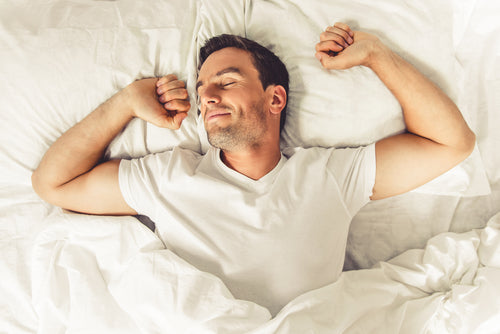 man smiling in bed