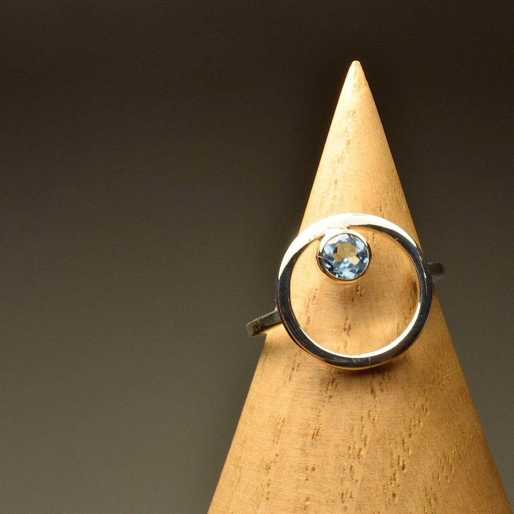 Belak with Blue Topaz Ring