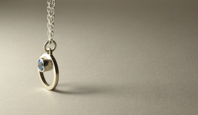 Belak with Blue Topaz Pendant