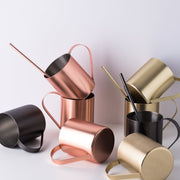 Stainless steel mugs with matching straws, matte plated.