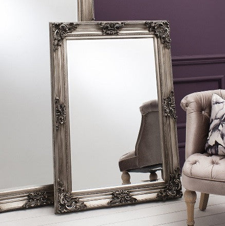 the carved louis wall mirror has ornate detailing around the corners and a deep gold colouration