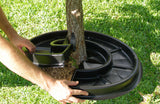 Mat is quickly and easily placed around a tree