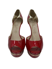 RED PATENT PEEP TOE PUMPS