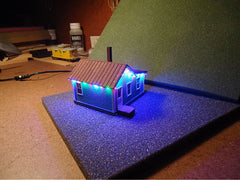 4-Color Light String on Tiny Cottage