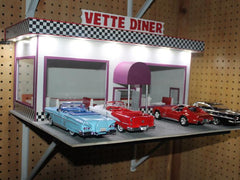 Cars in front of a diner