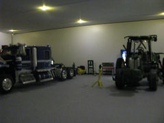 Farm tractors in garage