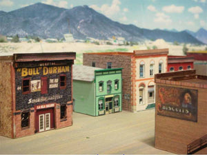 Great old west town.  Buildings made using the layering method.  Cut out windows and doors on one copy and put a second uncut copy behind  see  click for pictures of this town all made with Model Builder