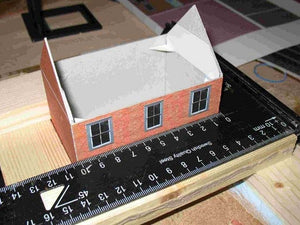 start of a cottage, the customer's first Model Builder project. Note the use of the square for construction, and corner bracing inside the model