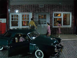 Cammie's Red Crown Gas & Groceries. This busy 1:24 scale scene shows of the great die cast car