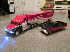 Pink truck and car