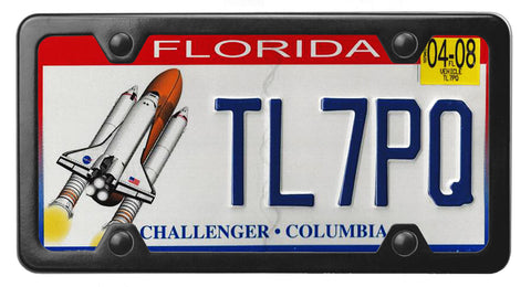 Florida specialty license plate with Challenger and Columbia on it inside of StreamlineJK Black powdered Stainless Steel license plate frame