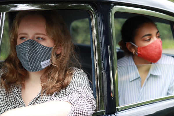 Ladies in a car wearing Washable Face Masks