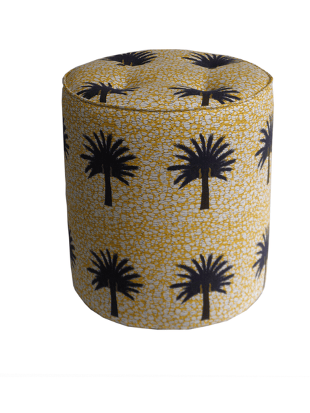 Vibrant yellow African print pouffe with large black and brown tropical palm tree