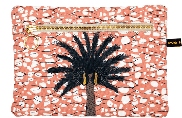 Colourful terracotta pink African print  batik print bag with large tropical palm tree and gold zip