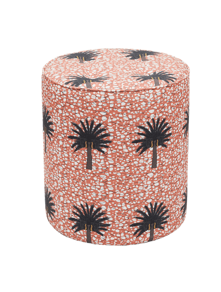 Bright baby pink African print pouffe with large green and brown tropical palm tree