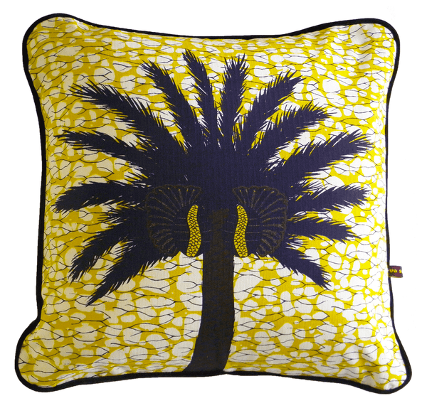 Colourful and bold yellow African batik print cushion with large tropical palm tree